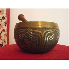 Picture of Tibetan Singing Bowl; with Grey-Black Coating on Outer/Inner Surface; 4.5in Diameter; 495grams weight.
